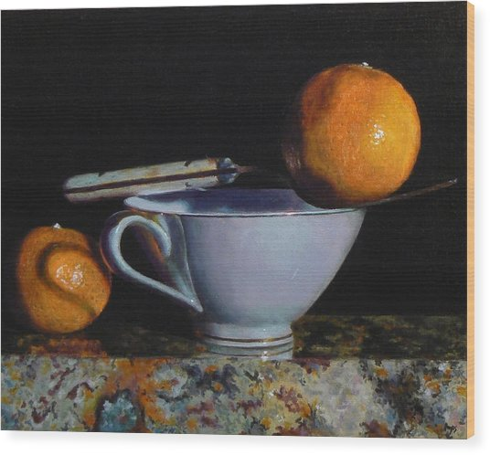 Teacup, Fork, And Two Oranges On Granite Wood Print by Jeffrey Hayes