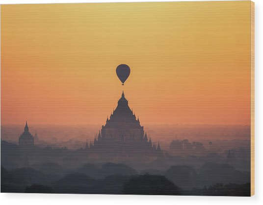 temples in Bagan with hot air balloon for traval on sun rise and Wood Print by Anek Suwannaphoom