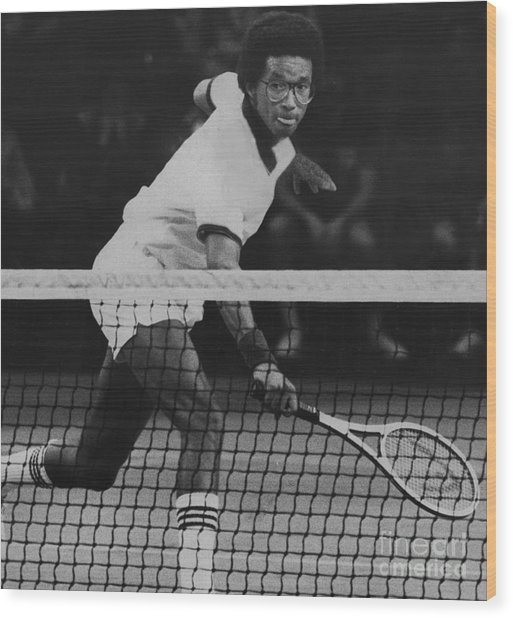 Tennis Great, Arthur Ashe, Returns The Ball At The Atp Worls Tour Finals In 1979. Wood Print by Bob Olen