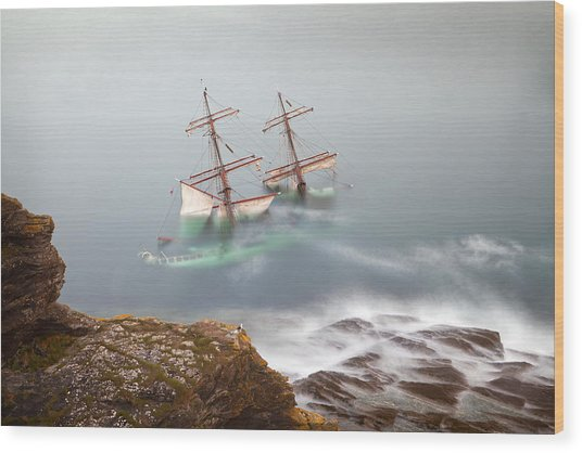 The Astrid Goes Aground Wood Print by Alan Mahon