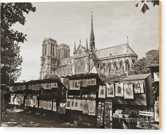 The Bouquinistes And Notre-dame Cathedral Wood Print