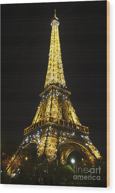The Eiffel Tower At Night Illuminated, Paris, France. Wood Print
