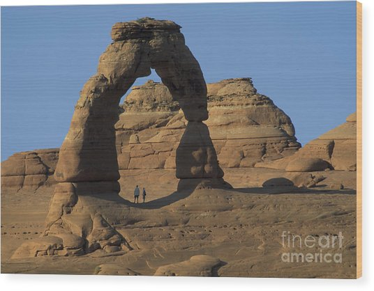 The Scale Of Delicate Arch Wood Print by Stan and Anne Foster