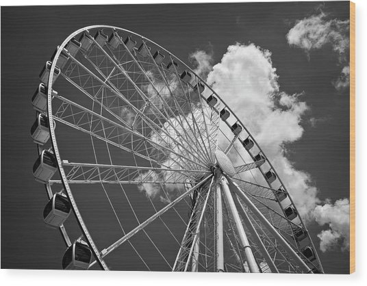 The Wheel And Sky In Black And White Wood Print