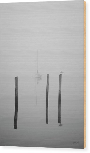 Three Pilings And Sailboat Wood Print