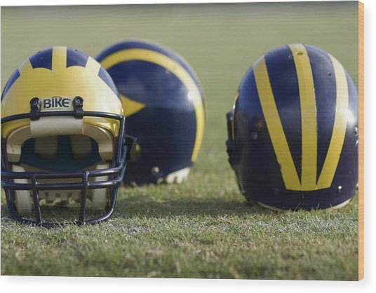 Three Wolverine Helmets Wood Print