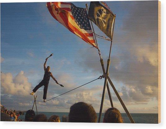 Tight Rope Walker In Key West Wood Print by Carl Purcell