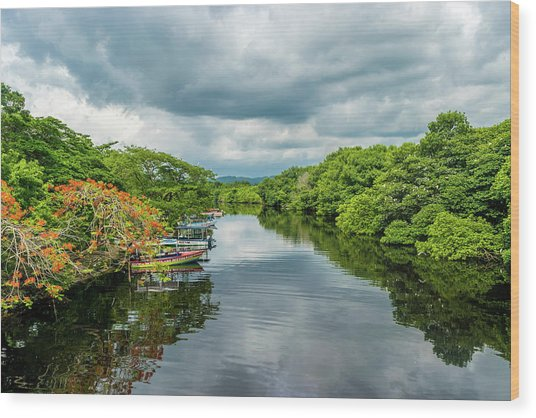Cloudy Skies Over The River Wood Print