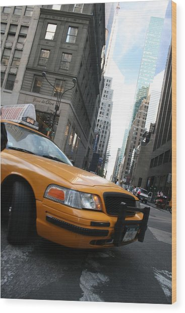 Turning Taxi Wood Print by Jeff Porter