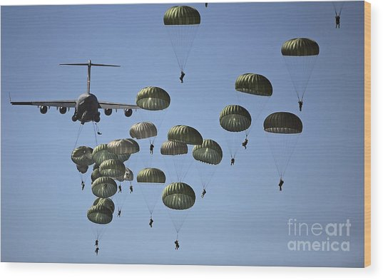 Wood Print featuring the photograph U.s. Army Paratroopers Jumping by Stocktrek Images