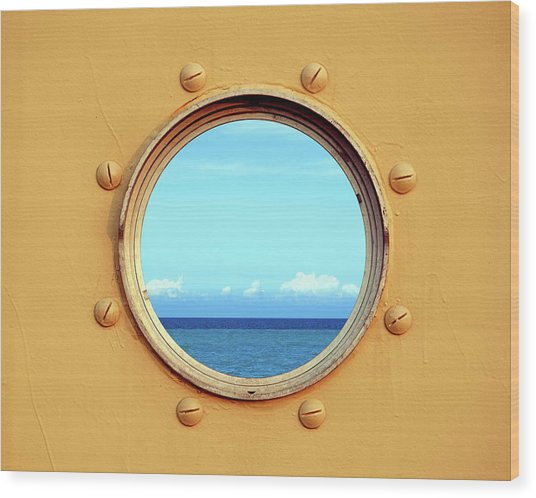 View Of The Ocean Through A Porthole Wood Print