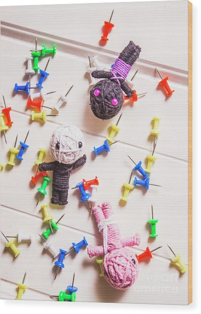 Voodoo Dolls Surrounded By Colorful Thumbtacks Wood Print