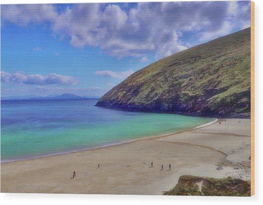 Walkers On Keem Beach, Achill Island Feted By The Green Atlantic Ocean. Wood Print by Paul Mc Namara