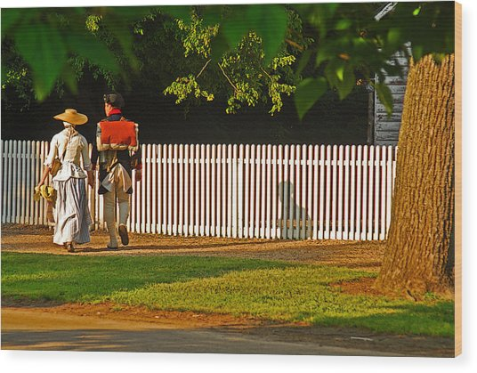 Walking Couple - Williamsburg Wood Print by Panos Trivoulides