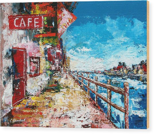 Waterfront Cafe Wood Print by Claude Marshall