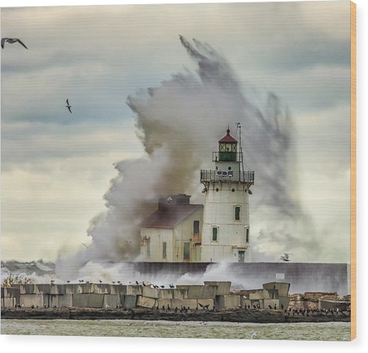 Waves Over The Lighthouse In Cleveland. Wood Print