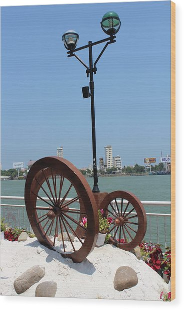 Wheels By The Water Wood Print