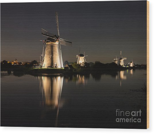 Windmills Illuminated At Night Wood Print