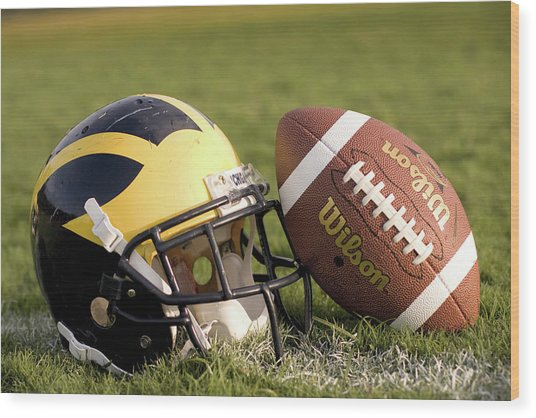 Wolverine Helmet With Football On The Field Wood Print