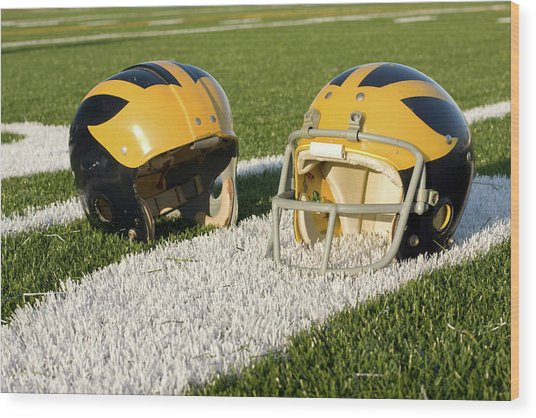 Wolverine Helmets From Different Eras On The Field Wood Print