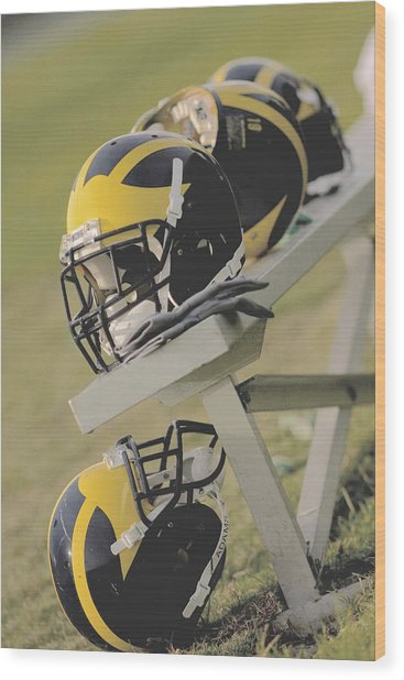 Wolverine Helmets On A Football Bench Wood Print