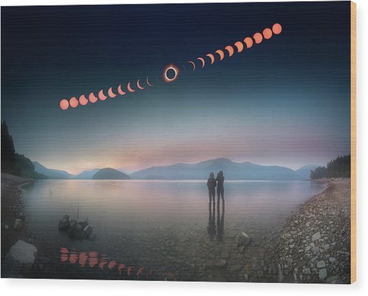 Woman And Girl Standing In Lake Watching Solar Eclipse Wood Print