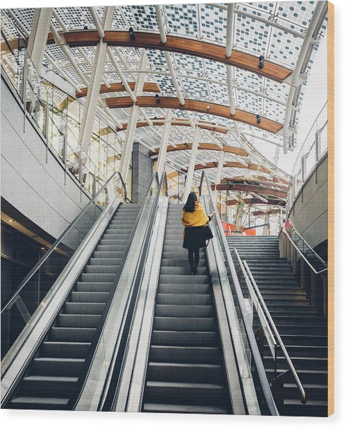 Woman Going Up Escalator In Milan, Italy Wood Print