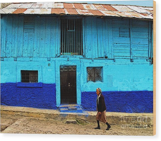 Woman Walking By The Blue House Wood Print by Mexicolors Art Photography