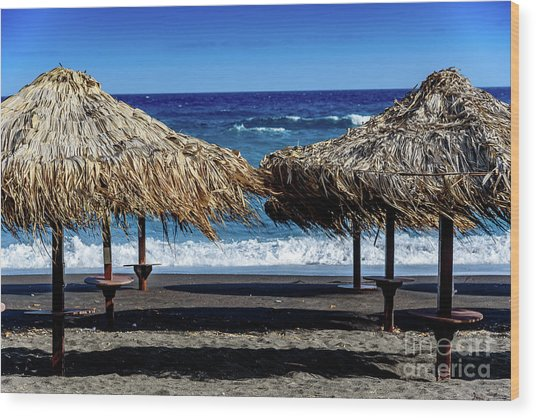 Wood Thatch Umbrellas On Black Sand Beach, Perissa Beach, In Santorini, Greece Wood Print