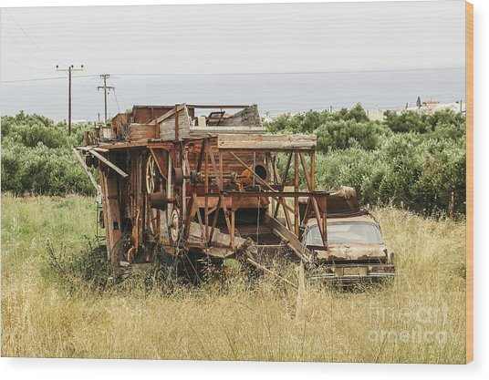 Worn Out Harvester And Car Wood Print by Kim Lessel