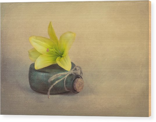 Yellow Lily And Green Bottle Wood Print