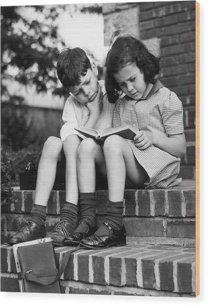 Young Boy & Girl Reading A Book Outdoors Wood Print by George Marks