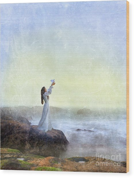 Young Lady Releasing A Dove By The Sea Wood Print