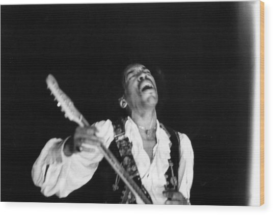 Jimi Hendrix Performs At Monterey Wood Print by Michael Ochs Archives