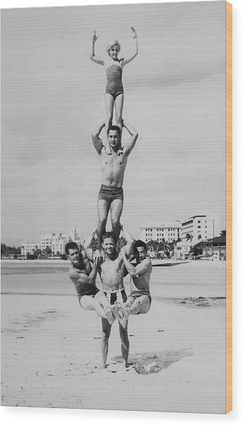 Men And Girl Perform Acrobatics On Beach Wood Print