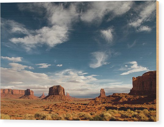 Monument Valley With Dramatic Clouds Wood Print