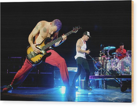 Red Hot Chili Peppers Perform At O2 Wood Print by Neil Lupin