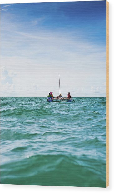 Sailing On A Makeshift Handmade Raft Wood Print