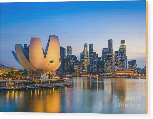 Singapore Skyline At The Marina During Wood Print by Sean Pavone