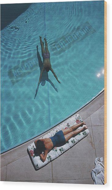 Swimmer And Sunbather Wood Print by Slim Aarons