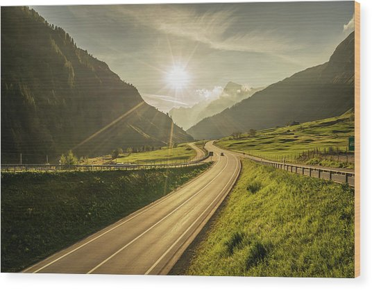 Traffic On A Mountain Road Wood Print by Buena Vista Images