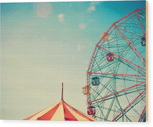 Vintage Colorful Ferris Wheel Over Blue Wood Print