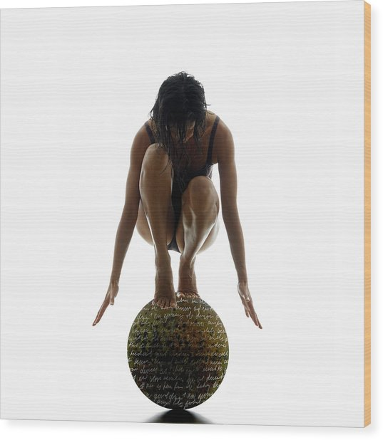 Woman Balancing On Globe Wood Print by Alfonse Pagano