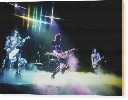 Kiss Performing Wood Print by Michael Ochs Archives