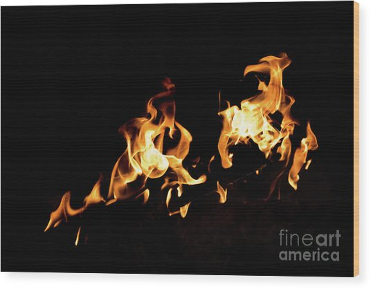 Flames In The Fire Of A Red And Yellow Barbecue. Wood Print