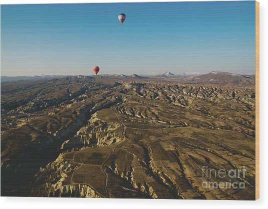 Colorful Balloons Flying Over Mountains And With Blue Sky Wood Print