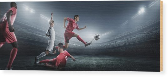 Soccer Player Kicking Ball In Stadium Wood Print by Dmytro Aksonov