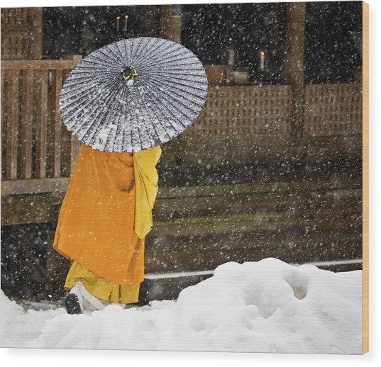 A Buddhist Monk Walks Through A Snow Wood Print by Mint Images - Art Wolfe