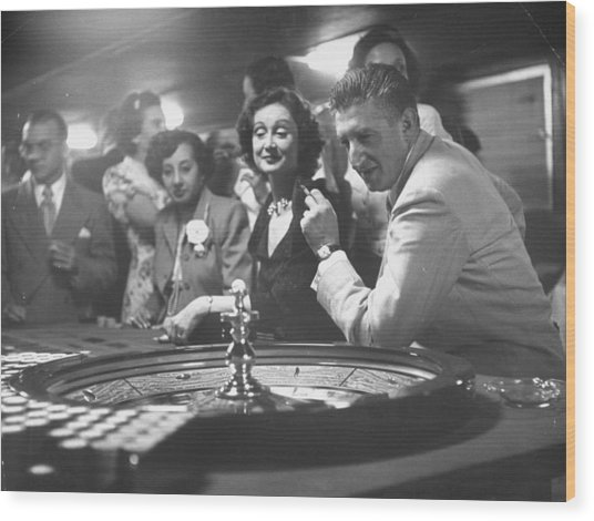 A Group Of People Gambling At A Roulette Wood Print by Gordon Parks