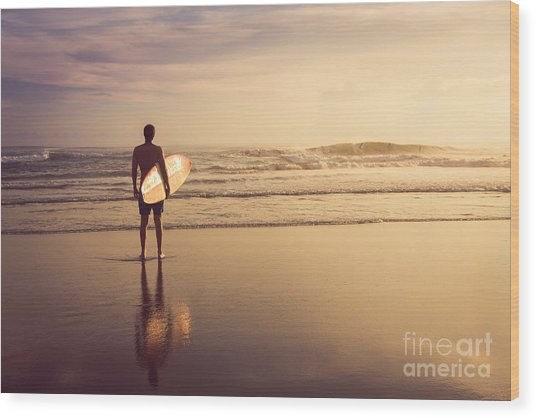 A Man Is Standing With A Surf In His Wood Print